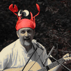 Dave Horn singing a kids' song and wearing a lobster on his head